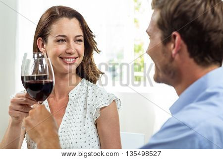 Happy couple toasting wineglasses at home