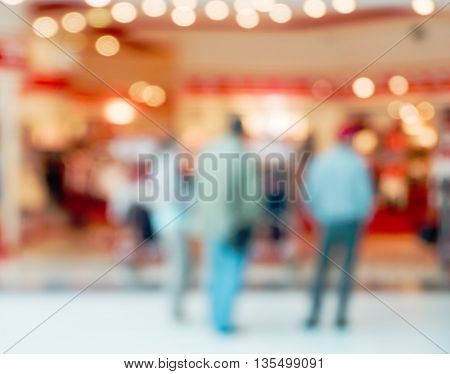 Abstract blurred shopping mall hall with unrecognizable persons as background