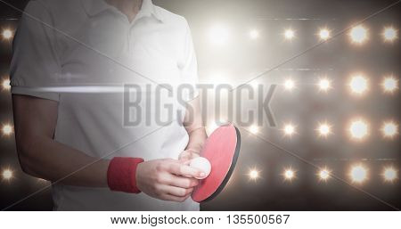 Composite image of female athlete posing with ping pong racket against spotlight