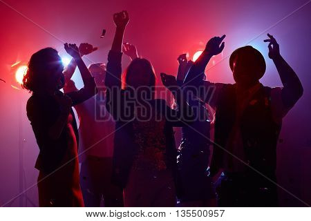 Group of young people spending time at nightclub