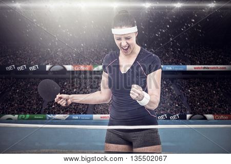 Composite image of female table tennis player posing after victory in a stadium