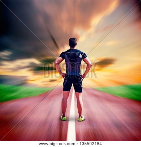 Composite image of athlete man posing with hands on hips against blurred background