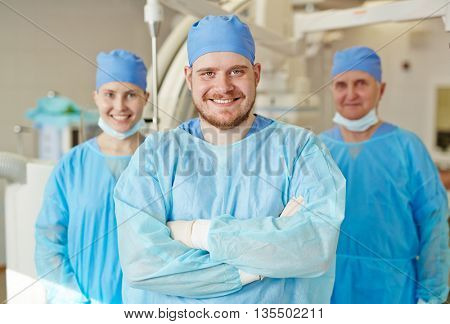 Portrait of successful team of surgeons smiling at camera