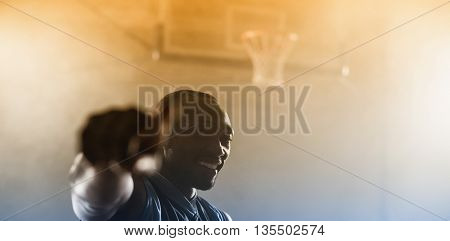 Portrait of a smiling basketball player in a gymnasium