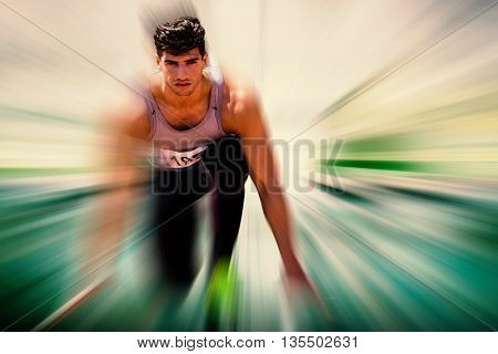 Composite image of sportsman waiting on the starting line against blurred background