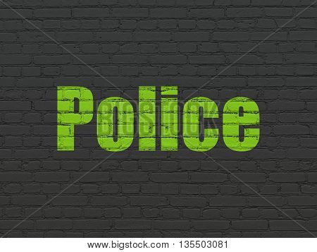 Law concept: Painted green text Police on Black Brick wall background