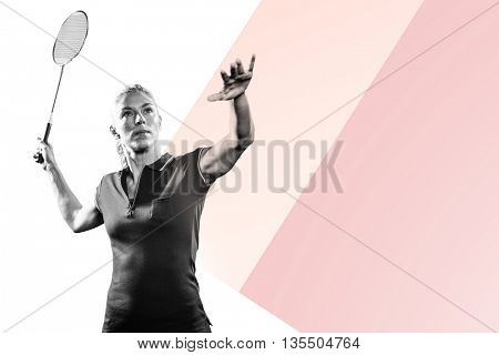 Badminton player playing badminton against bright blue