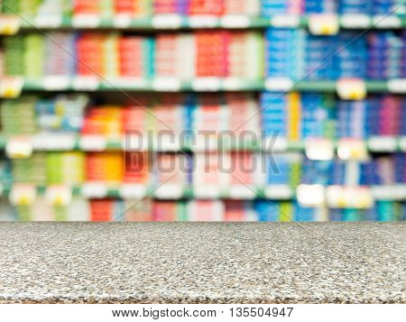 Marble board empty table in front of blurred background. Perspective marble over blur in supermarket - can be used for display or montage your products. Mock up for display of product.