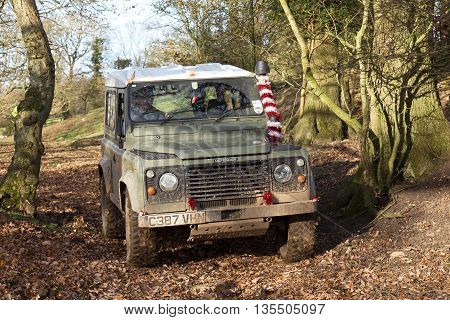 GREAT MALVERN, UK - DECEMBER 8: An unnamed driver competing in the SCOR UK trials championship passes a wooded gate section at the Croft Farm round on December 8, 2013 in Great Malvern