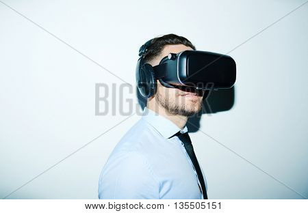 Businessman in vr goggles and headphones