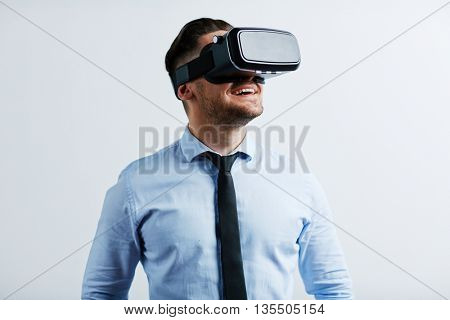 Young businessman trying vr goggles