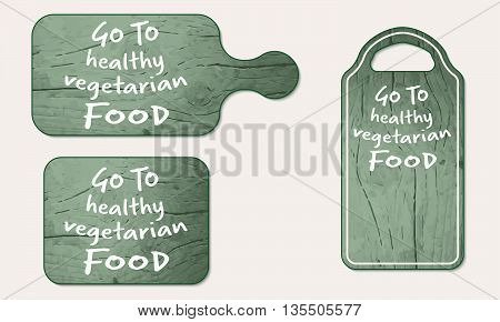 Wooden breadboard with the words go to vegetarian food