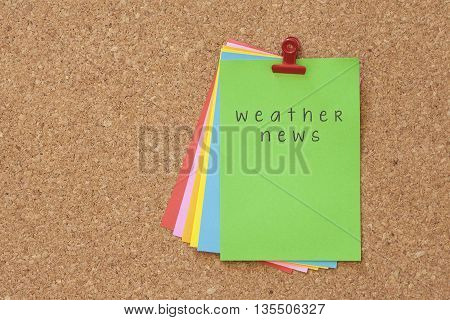 weather news on color sticker notes over cork board background