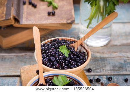 fresh bilberry with green parsley in crockery dish