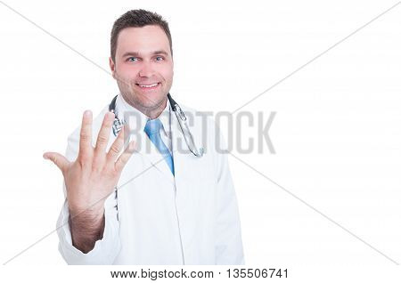 Medic Smiling And Showing Number Five With One Hand