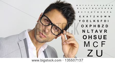 man holding his glasses over a white background