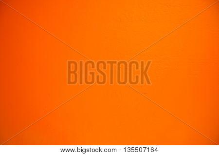 cement orange background, wall of orange background