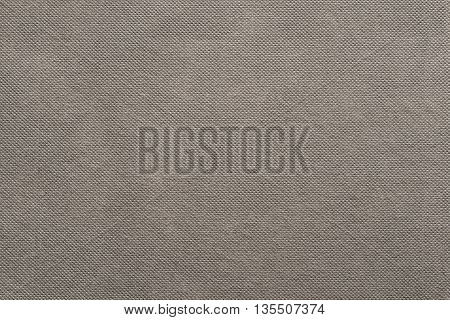 the grooved textured design of fabric with pile for the abstract background and for wallpaper of beige color