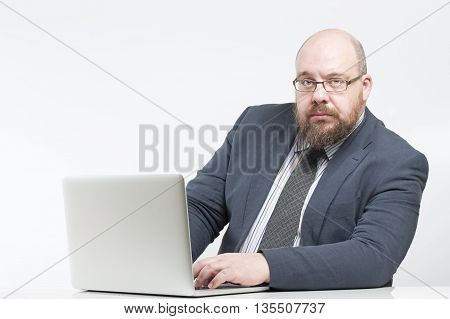 Business Man Working At A Computer..