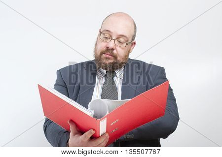 Business Man Studies Folder With Documents..