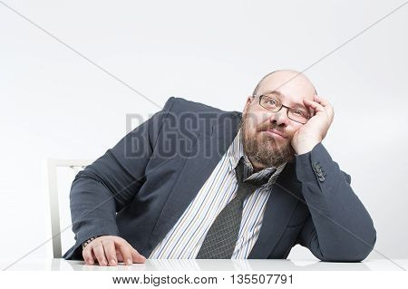 Pensive Businessman Sitting At The Table..