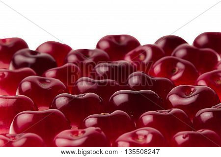 Heap of sweet cherries close-up. Cherry background. Fruit background. Isolated.