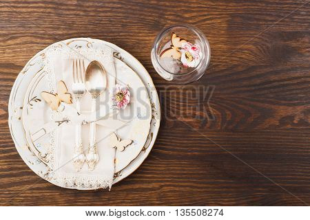 Utensil and silverware with decorations on the wooden background