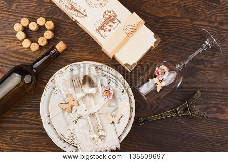 Tableware and silverware with decorations on the wooden background