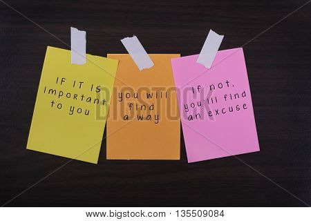 Word quotes of IF IT IS IMPORTANT TO YOUYOU WILL FIND A WAYIF NOT YOU'LL FIND AN EXCUSE on colorful sticky papers against wooden textured background.