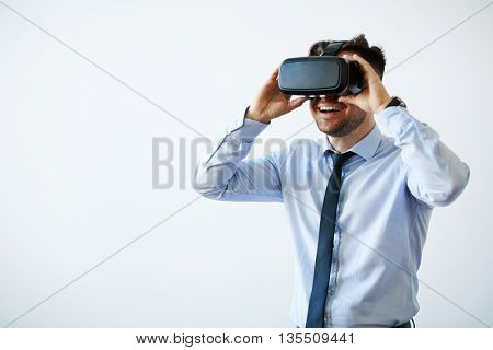 Portrait of excited businessman in vr goggles
