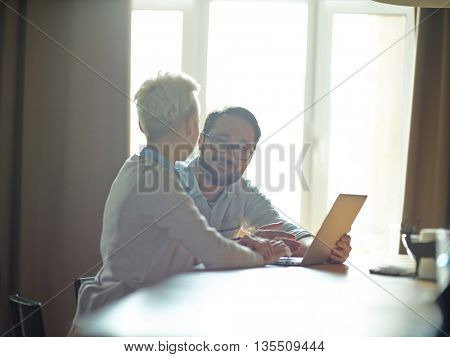 Man and woman discussing talking in office during work