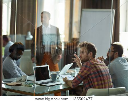 Briefing in young creative company among male workers
