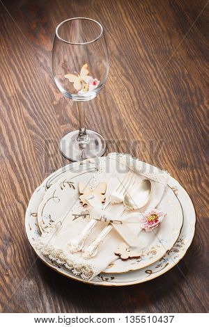 Utensil and silverware with decorations and flowers on the wooden background