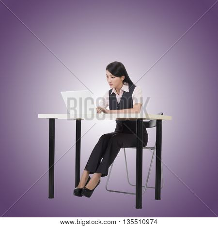 Asian business woman sit and work, full length portrait.