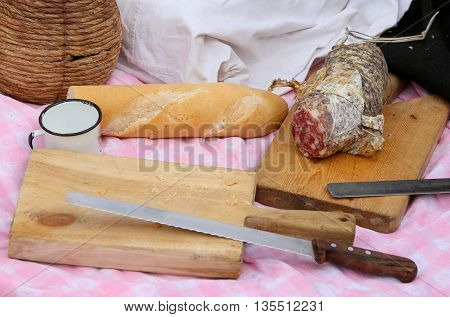 Outdoor Picinc With Salami, Fragrant Bread And Big Knife