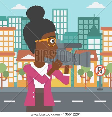 An african-american camerawoman with video camera taking a video on a city background vector flat design illustration. Square layout.