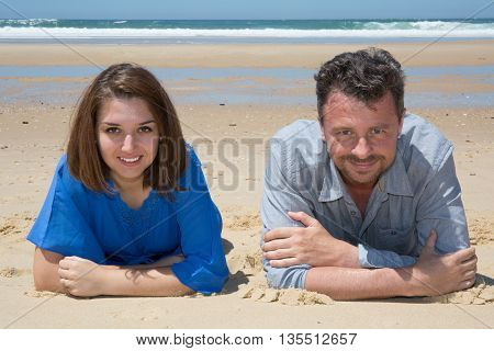 Cheerful And Smiling Man And Woman Enjoying Beach Holiday