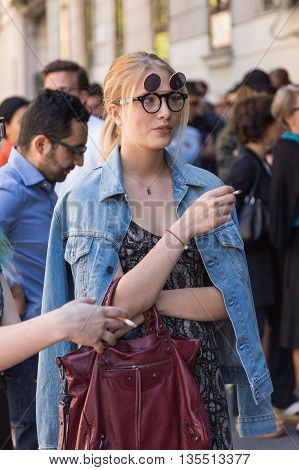 MILAN ITALY - JUNE 20: Fashionable woman poses outside Etro fashion show building during Milan Men's Fashion Week on JUNE 20 2016 in Milan.