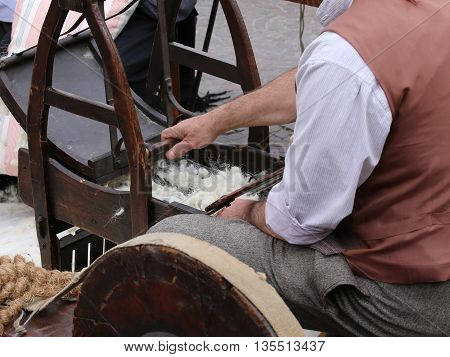 Elder Carder While Carding Wool Or Cotton With Old Wooden Machin