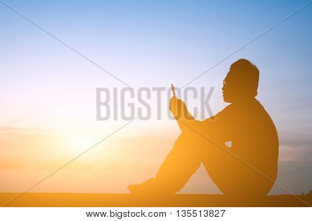 silhouette of one man use cellphone in the outside