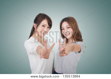 Asian women give you a sign of victory.