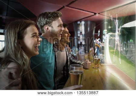 Composite image of friends are watching tennis match in a pub