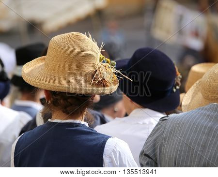 Woman With Straw Hat In The Crowd