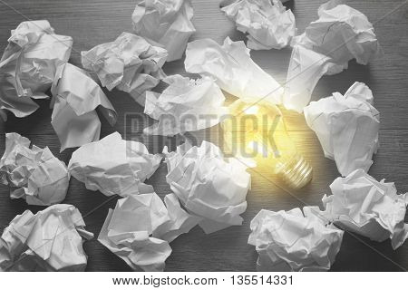 light and letter paper on wooden background