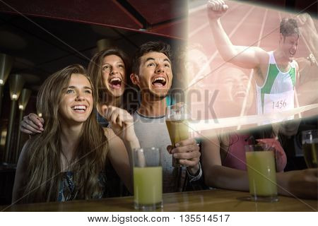 Composite image of friends are watching athletics race in a oub