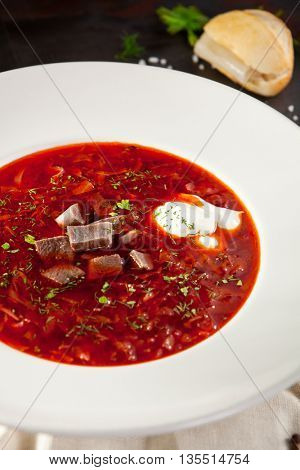 Beetroot and Cabbage Soup with Beef, Garnished with Sour Cream