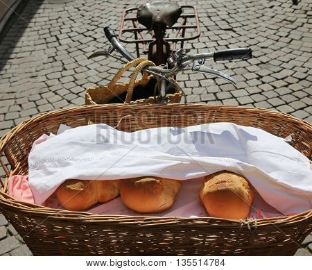 Baker's Old Bicycle With Basket With  Pieces Of Fragrant Bread