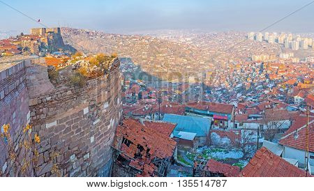 The old houses huddle close to the wall or share the common wall with the medieval citadel Ankara Turkey.