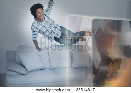 Composite image of excited man are watching sport on television at home