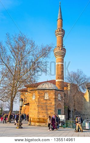 ANKARA TURKEY - JANUARY 16 2015: The worshipers are going to the Haci Bayram Mosque for Salat (the Muslim prayer) on January 16 in Ankara.